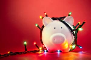 Christmas savings piggy bank with Christmas lights
