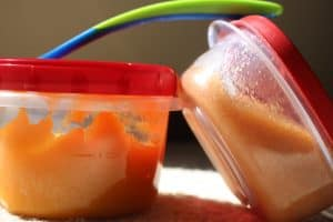 baby food in storage containers and baby food spoon