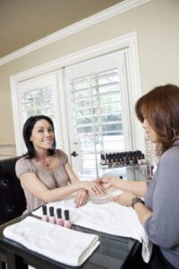 married woman getting manicure