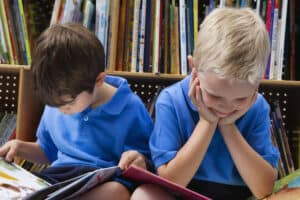boys at library reading books