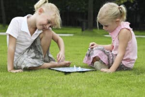 girls playing board game outside