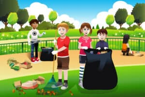 kids volunteering by cleaning up park