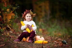 little girl dressed for fall activities with family