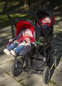 two babies in tandem double stroller