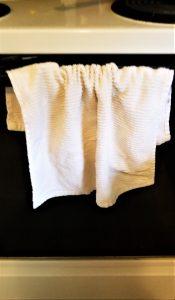 baby proofing hacks- towel on oven door handle
