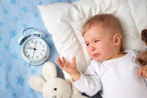 daylight savings sleep routine, baby with alarm clock
