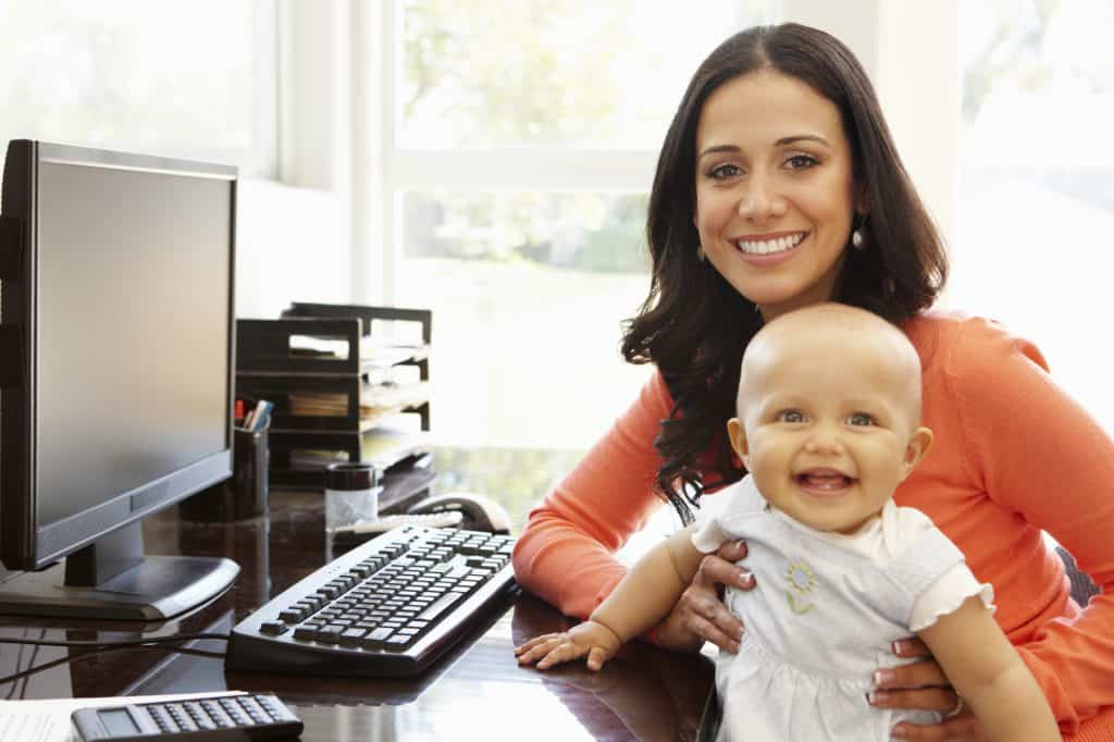 going back to work after a baby- mother and baby at desk