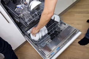 emptying clean dishwasher