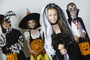 kids dressed in Halloween costumes