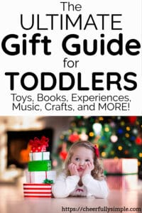 toddler Christmas gift guide with toddler waiting to open Christmas gifts