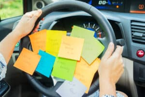 mom with post-it notes who needs a mom planner