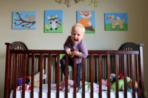 crying toddler trying to get out of the crib