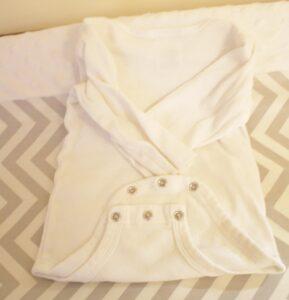 folding a onesie step 2
