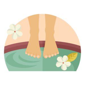 woman's feet soaking in tub of salt water